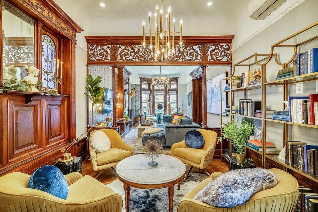 Queen Anne Victorian brownstone parlor with glam decor in our design interview